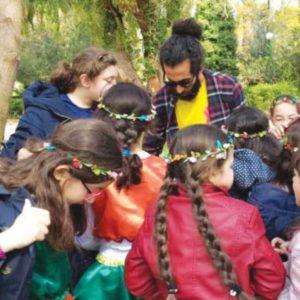 A teacher facilitating an activity with his students