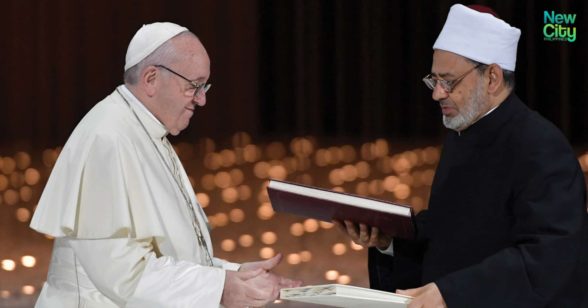 A moment of the signing of the Document on Human Fraternity by Pope Francis and the Grand Imam of Al-Azhar, Ahmed Al-Tayeb;